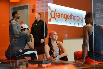 Customers in Orangetheory Fitness lobby